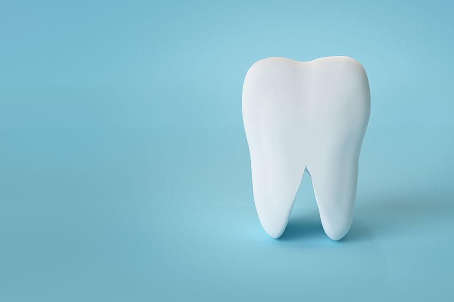 青い背景の歯のイメージ